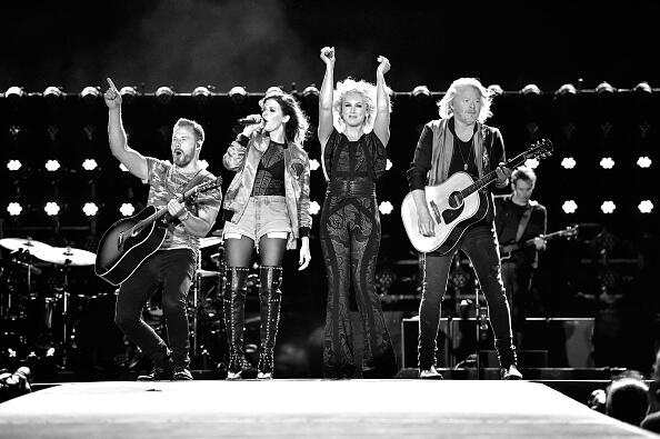 LAS VEGAS, NV - OCTOBER 02:  (EDITORS NOTE: Image has been converted to black and white.) (L-R) Recording artists Jimi Westbrook, Karen Fairchild, Kimberly Schlapman and  Phillip Sweet of Little Big Town perform during the Route 91 Harvest country music festival at the Las Vegas Village on October 2, 2016 in Las Vegas, Nevada.  (Photo by David Becker/Getty Images)