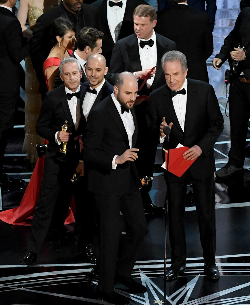 HOLLYWOOD, CA - FEBRUARY 26: : 'La La Land' producer Jordan Horowitz (L) announces actual Best Picture winner as 'Moonlight' after a presentation error with actor Warren Beatty onstage during the 89th Annual Academy Awards at Hollywood & Highland Center on February 26, 2017 in Hollywood, California.  (Photo by Kevin Winter/Getty Images)