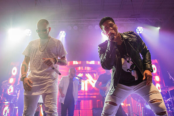 HOUSTON, TX - AUGUST 13:  Nacho (L) and Chino of Chino y Nacho take the stage at the Bud Light Party Convention in Houston, August 13, 2016. Bud Light - America's most popular and inclusive beer brand - is taking the Bud Light Party on the road with 13-city Convention Tour from 8/5-8/27 at Silver Street Studios on August 13, 2016 in Houston, Texas.  (Photo by Rick Kern/Getty Images for Bud Light)