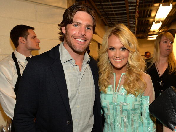 NASHVILLE, TN - JUNE 05:  Singer Carrie Underwood (R) and  Mike Fisher attend the 2013 CMT Music awards at the Bridgestone Arena on June 5, 2013 in Nashville, Tennessee.  (Photo by Rick Diamond/Getty Images)