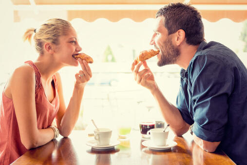 Young couple have breakfast at italian café