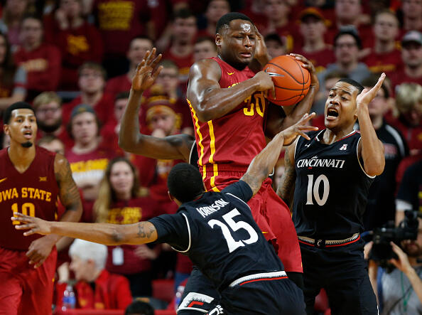 AMES, IA - DECEMBER 1:  Deonte Burton #30 of the Iowa State Cyclones battles for a rebound with Kevin Johnson #25, and Troy Caupain #10 of the Cincinnati Bearcats in the second half of play at Hilton Coliseum on December 1, 2016 in Ames, Iowa. The Cincinnati Bearcats won 55-54 over the Iowa State Cyclones. (Photo by David Purdy/Getty Images)