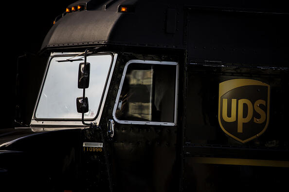 An employee drives a delivery truck out of a United Parcel Service Inc. (UPS) distribution facility on Cyber Monday in New York, U.S., on Monday, Nov. 30, 2015. Online sales on Cyber Monday may rise at least 18 percent from a year earlier, slower growth than during the holiday weekend, as consumers start their Internet shopping earlier, according to forecasts by International Business Machines Corp. Photographer: John Taggart/Bloomberg via Getty Images