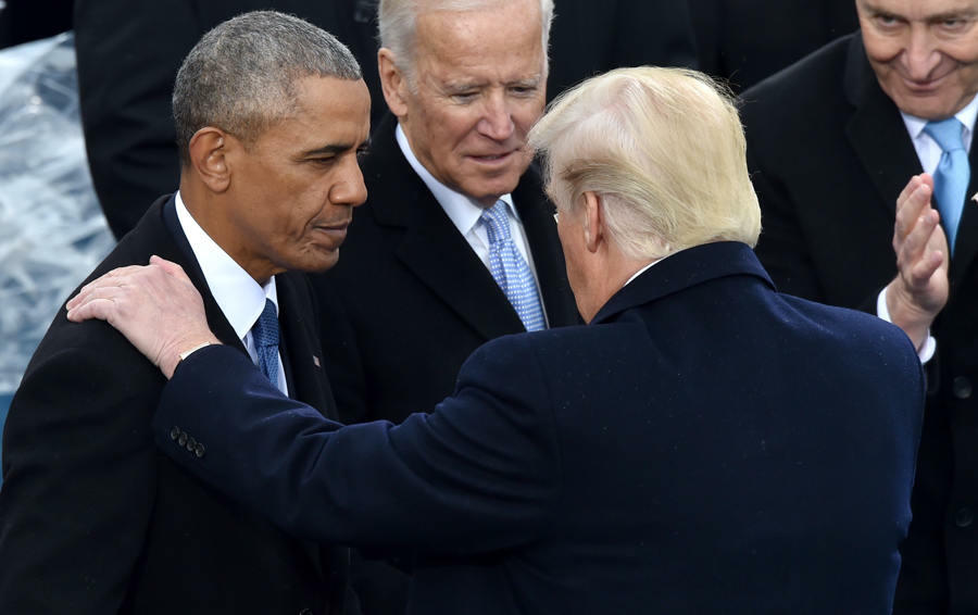 US President Donald Trump(C)speaks with former President Barack Obama as former Vice President Joe Biden and New York Sen. Chuck Schumer look on during his inauguration ceremonies at the US Capitol in Washington, DC, on January 20, 2017. / AFP / Paul J. R