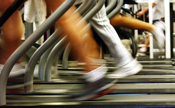 BROOKLYN, NEW YORK - JANUARY 2:  People run on treadmills at a New York Sports Club January 2, 2003 in Brooklyn, New York. Thousands of people around the country join health clubs in the first week of the new year as part of their New Year's resolution. M