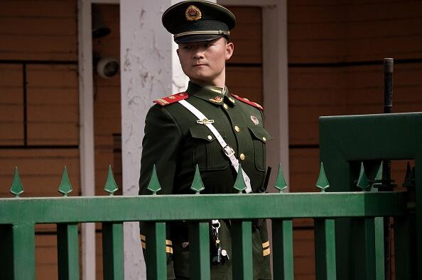 A paramilitary police officer stands guard in front of the North Korean embassy in Beijing on March 6, 2017.   Nuclear-armed North Korea launched four ballistic missiles in another challenge to President Donald Trump, with three landing provocatively close to America's ally Japan. / AFP PHOTO / NICOLAS ASFOURI        (Photo credit should read NICOLAS ASFOURI/AFP/Getty Images)