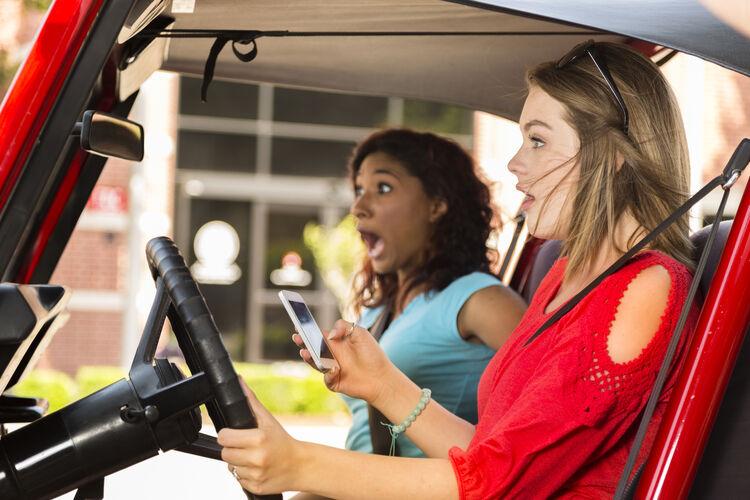 Multi-ethnic teenage girls texting while driving their car. Crash!