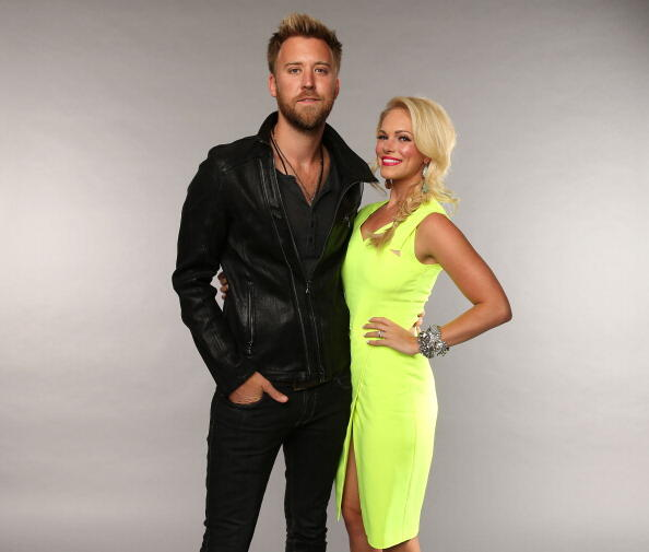 NASHVILLE, TN - JUNE 05:  Charles Kelley of the band Lady Antebellum and wife Cassie McConnell pose at the Wonderwall portrait studio during the 2013 CMT Music Awards at Bridgestone Arena on June 5, 2013 in Nashville, Tennessee.  (Photo by Christopher Pol