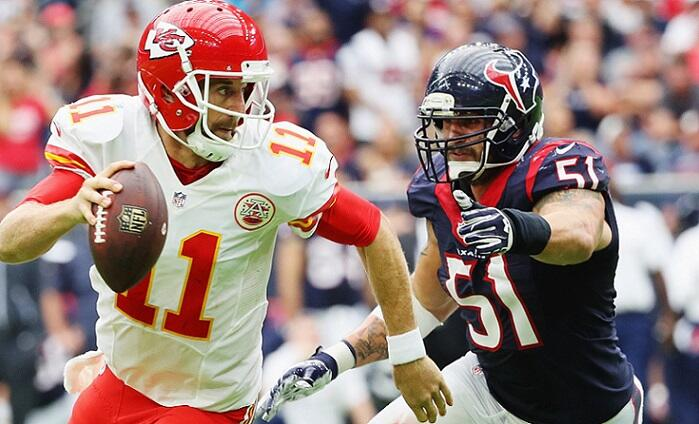 HOUSTON, TX - SEPTEMBER 18:  Alex Smith #11 of the Kansas City Chiefs runs away from the tackle of  John Simon #51 of the Houston Texans in the third quarter of their game at NRG Stadium on September 18, 2016 in Houston, Texas.  (Photo by Scott Halleran/G