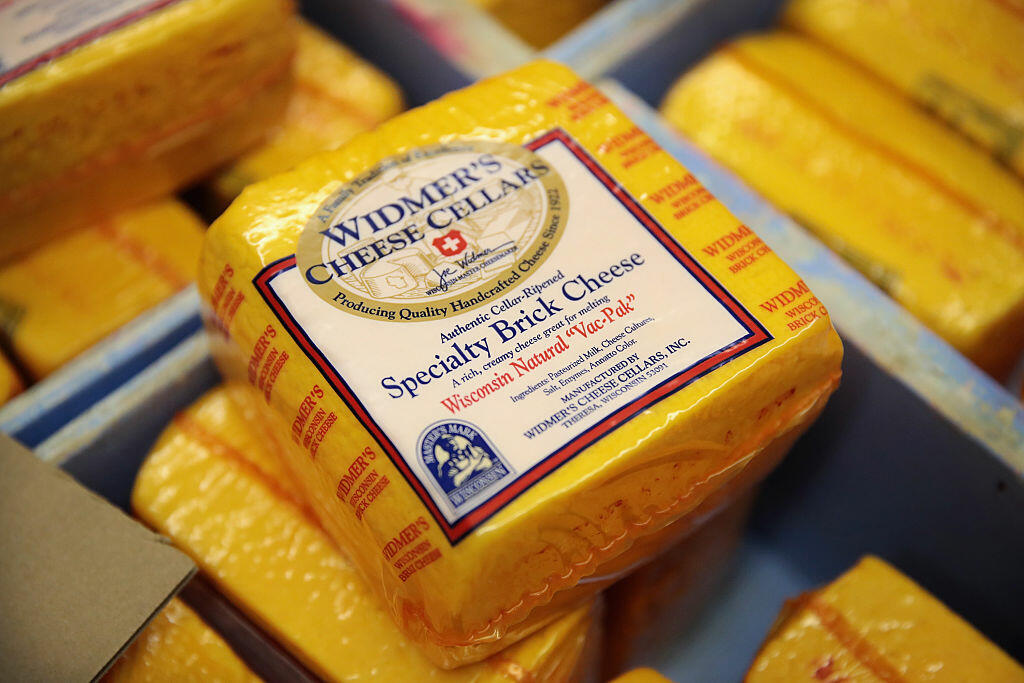 THERESA, WI - JUNE 27: Brick cheese packages are prepared for shipping at Widmer's Cheese Cellars on June 27, 2016 in Theresa, Wisconsin. Widmer's is an artisanal cheesemaker that has produced cheese in the same facility for four generations much the same way as it was made by the founder, with traditional open vats and curds being stirred and scooped into molds by hand.  Record dairy production in the United States has produced a record surplus of cheese causing prices to drop. Despite this surplus Widmer's says it continues to see growth as consumers continue to gravitate toward craft-made food products.  (Photo by Scott Olson/Getty Images)