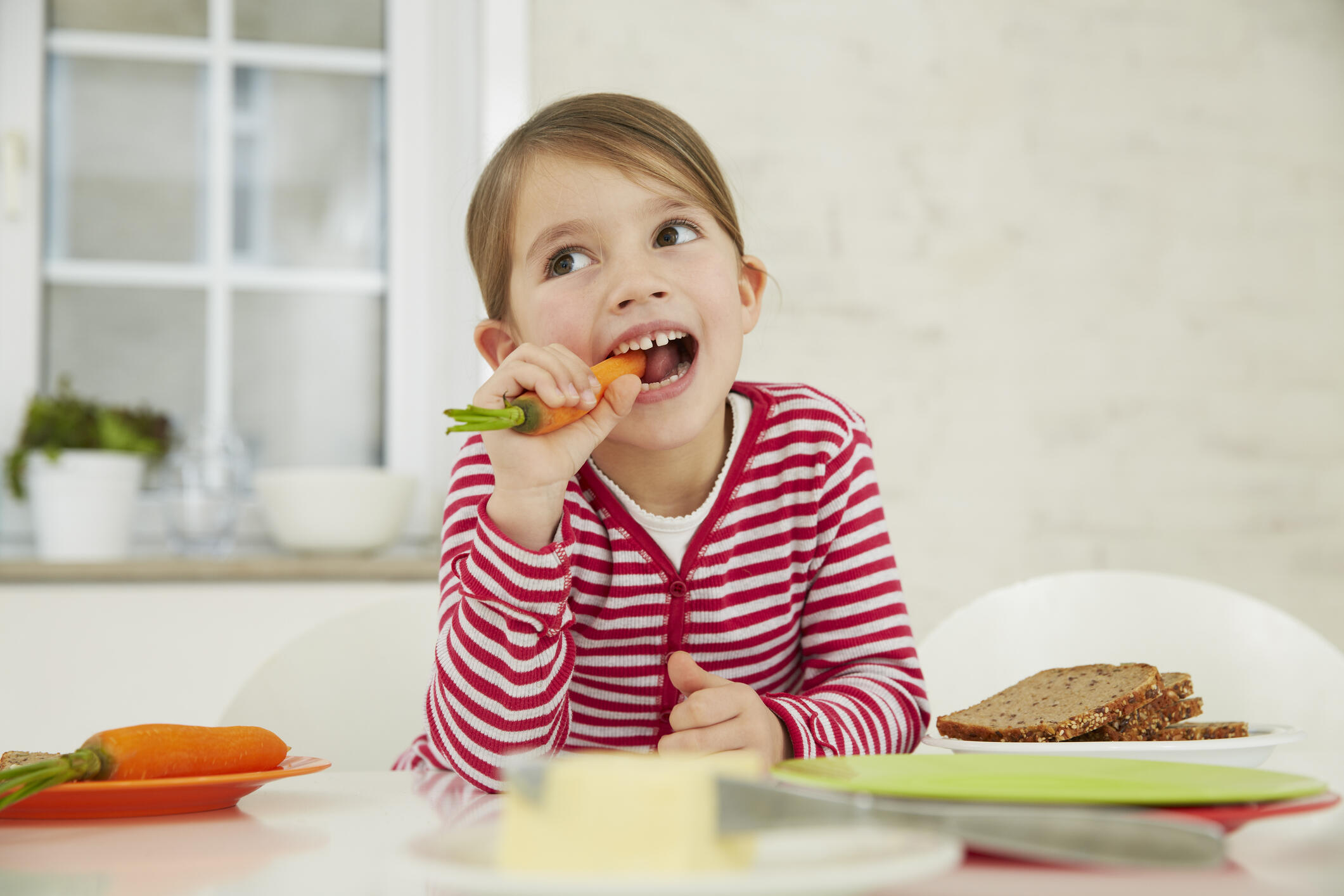 Image result for child eating carrot