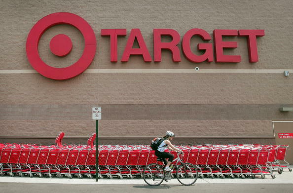 CHICAGO - MAY 23:  A bicyclist rides past a row of shopping carts outside a Target store on May 23, 2007 in Chicago, Illinois. Today, Target reported an 18 per cent increase in their quarterly earnings, beating analysts' expectations.  (Photo by Scott Ols