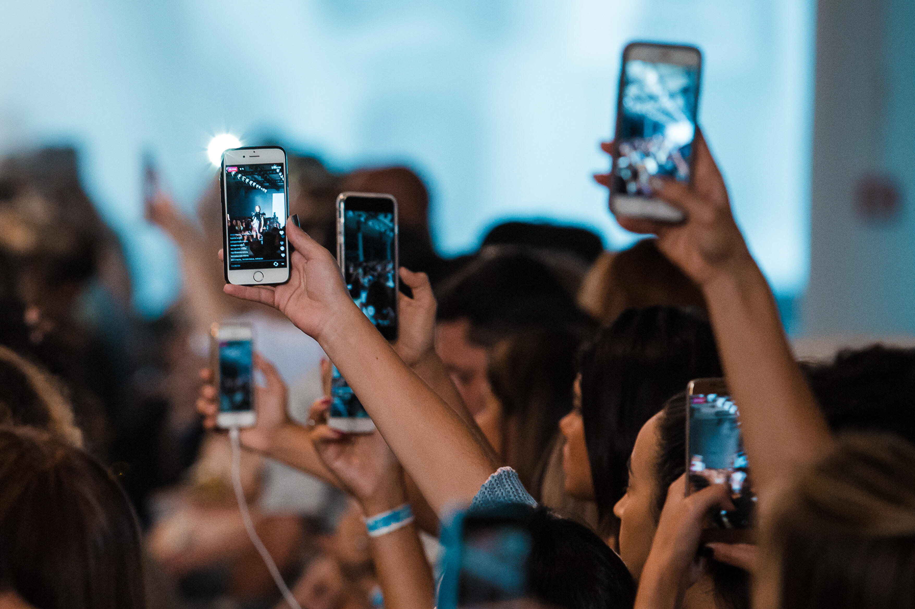 SAO PAULO, BRAZIL - MARCH 16: An alternative view of the audience with cell phones in live facebook and snapchat in Tig fashion show at Sao Paulo Fashion Week N 43 SPFW Fall/Winter 2017 on March 16, 2017 in Sao Paulo, Sao Paulo. (Photo by Mauricio Santana