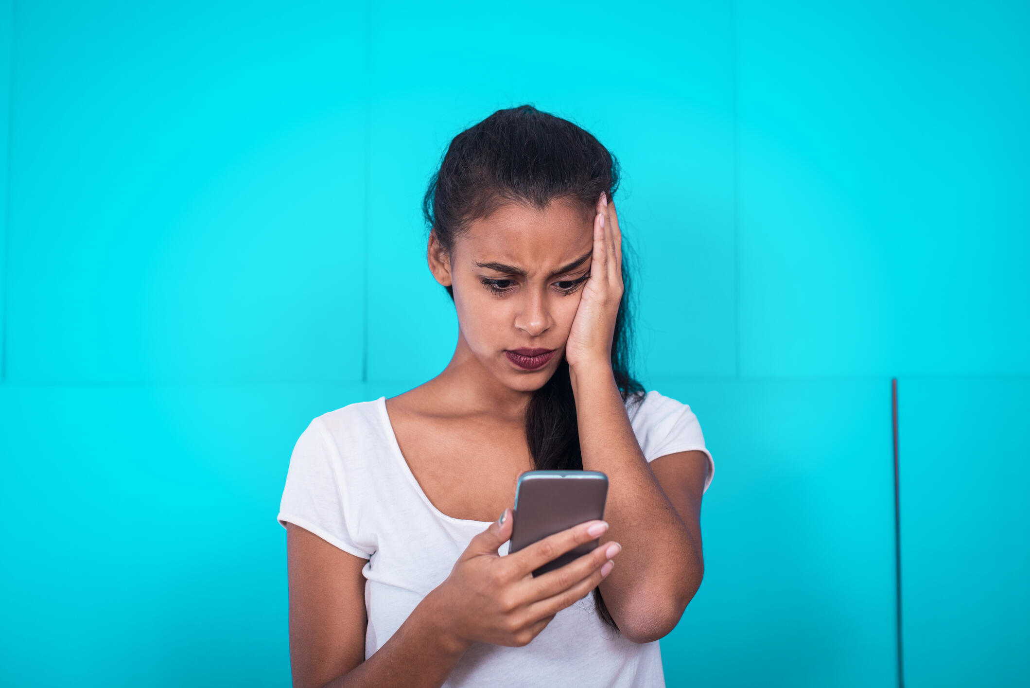 Young woman receive bad text message. Bad news