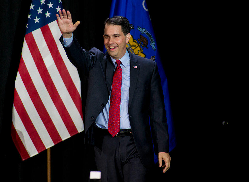 WEST ALLIS, WI - NOVEMBER 4: Wisconsin Gov. Scott Walker greets supporters at his election night party November 4, 2014 in West Allis, Wisconsin. Walker defeated Democratic challenger Mary Burke. (Photo by Darren Hauck/Getty Images)
