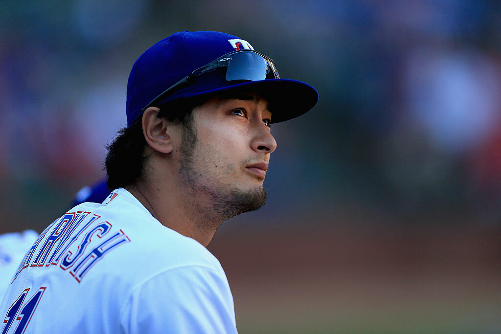 ARLINGTON, TEXAS - APRIL 04:  Yu Darvish #11 of the Texas Rangers looks on from the dugout as the Rangers take on the Seattle Mariners in the top of the eighth inning on Opening Day at Globe Life Park in Arlington on April 4, 2016 in Arlington, Texas.  (Photo by Tom Pennington/Getty Images)