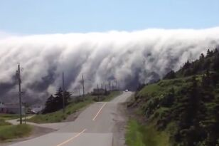 'Waves' of Clouds Crash Over Town