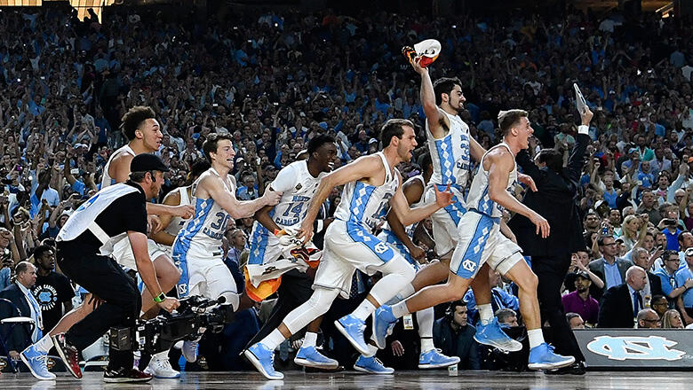 GLENDALE, AZ - APRIL 03: The North Carolina Tar Heels basketball team run on to the court after time expires during the 2017 NCAA Men's Final Four National Championship game at University of Phoenix Stadium on April 3, 2017 in Glendale, Arizona.  (Photo b