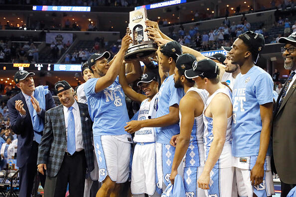 MEMPHIS, TN - MARCH 26:  The North Carolina Tar Heels hold up the South Regional Champion trophy after defeating the Kentucky Wildcats during the 2017 NCAA Men's Basketball Tournament South Regional at FedExForum on March 26, 2017 in Memphis, Tennessee.  (Photo by Kevin C. Cox/Getty Images)