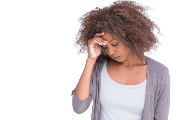Sad woman holding her forehead with her hand on white background