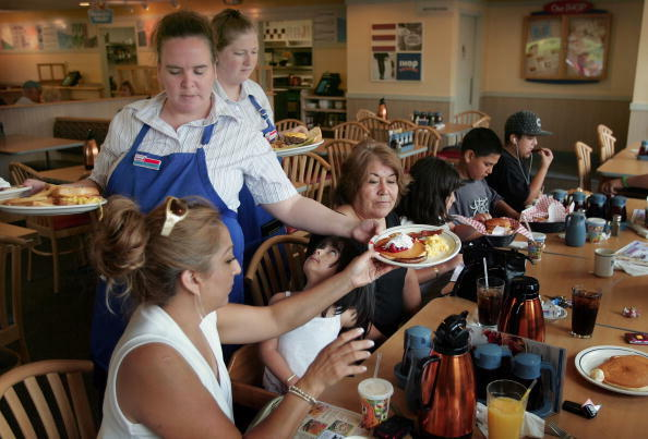 ELGIN, IL - JULY 16:  Waitresses Gretchen Boren (L) and Michelle Enright wait on customers at an IHOP restaurant July 16, 2007 in Elgin, Illinois. IHOP Corp. has agreed to purchase Applebee's International Inc. for about $2 billion.  (Photo by Scott Olson