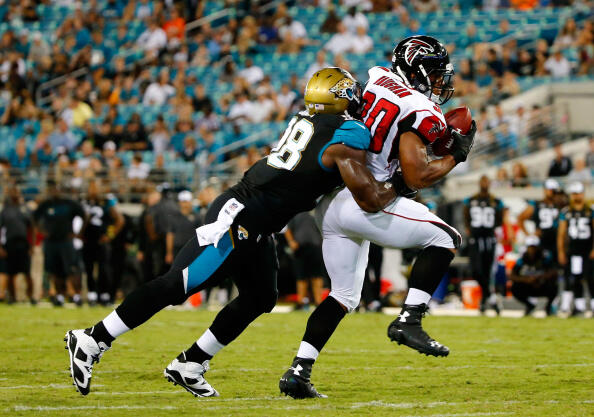 JACKSONVILLE, FL - AUGUST 28:  Josh Vaugh #30 of the Atlanta Falcons runs against  Chris Smith #98 of the Jacksonville Jaguars during the preseason NFL game at EverBank Field on August 28, 2014 in Jacksonville, Florida.  (Photo by Sam Greenwood/Getty Imag