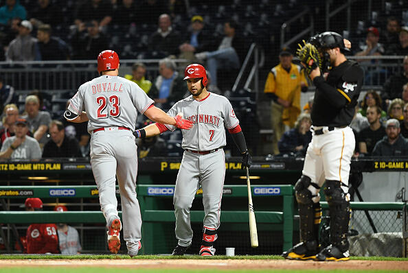PITTSBURGH, PA - APRIL 11:  Adam Duvall #23 of the Cincinnati Reds is greeted by Eugenio Suarez #7 after hitting a solo home run in the second inning during the game against the Pittsburgh Pirates at PNC Park on April 11, 2017 in Pittsburgh, Pennsylvania. (Photo by Justin Berl/Getty Images)