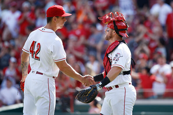 CINCINNATI, OH - APRIL 15: Michael Lorenzen #21 and Tucker Barnhart #16 of the Cincinnati Reds celebrate after the final out in the ninth inning of the game against the Milwaukee Brewers at Great American Ball Park on April 15, 2017 in Cincinnati, Ohio. The Reds defeated the Brewers 7-5. All players are wearing #42 in honor of Jackie Robinson Day. (Photo by Joe Robbins/Getty Images)