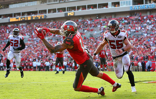 TAMPA, FL - DECEMBER 06:  Mike Evans #13 of the Tampa Bay Buccaneers catches the game-winning touchdown during the fourth quarter of the game against the Atlanta Falcons at Raymond James Stadium on December 6, 2015 in Tampa, Florida.  (Photo by Rob Foldy/Getty Images)