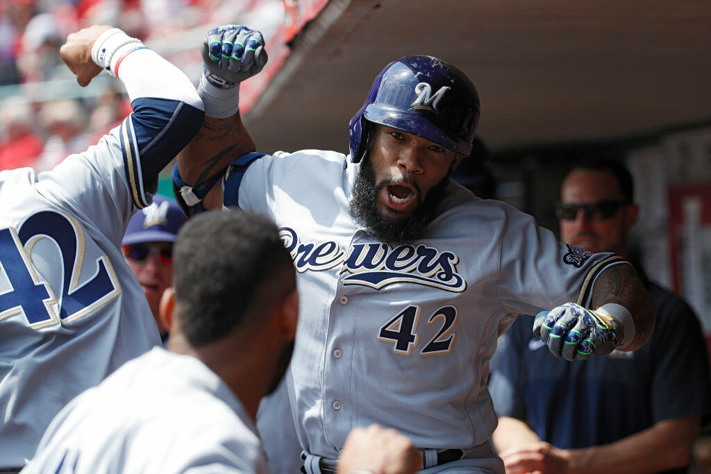 CINCINNATI, OH - APRIL 15: Eric Thames #7 of the Milwaukee Brewers celebrates in the dugout after hitting a solo home run to tie the game in the third inning against the Cincinnati Reds at Great American Ball Park on April 15, 2017 in Cincinnati, Ohio. All players are wearing #42 in honor of Jackie Robinson Day. (Photo by Joe Robbins/Getty Images)