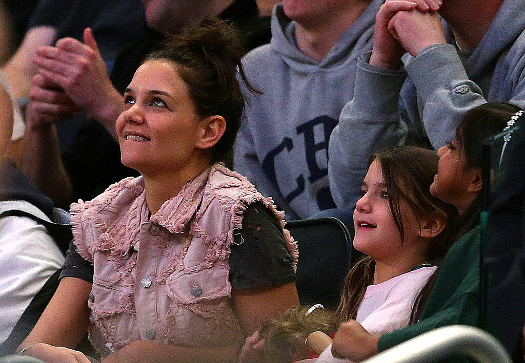 NEW YORK, NY - MARCH 30:  Actress Katie Holmes and her daughter Suri Cruise attend the East Regional Final of the 2014 NCAA Men's Basketball Tournament between the Connecticut Huskies and the Michigan State Spartans at Madison Square Garden on March 30, 2