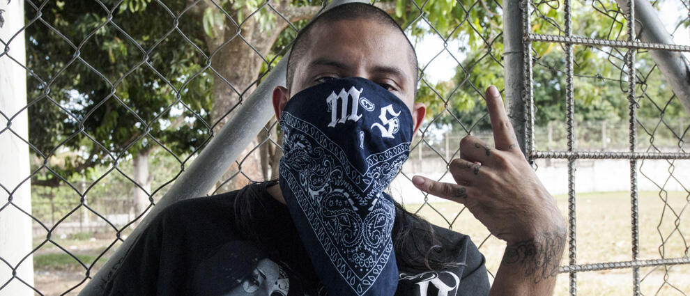 A Mara Salvatrucha gang member attends a press conference where leaders of the Mara Salvatrucha (MS-13) and Barrio 18 declared the city of Quezaltepeque a peace zone or