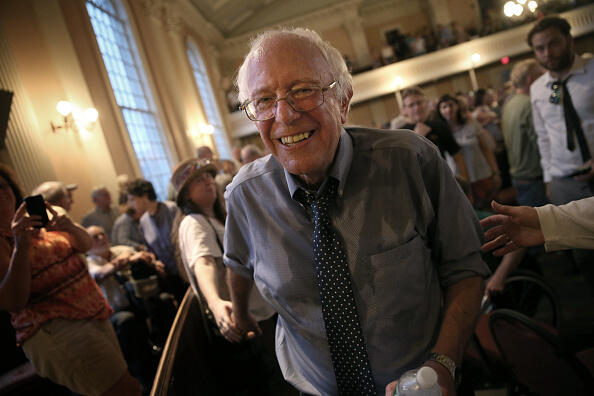 PORTSMOUTH, NH - MAY 27:  Democratic presidential candidate and U.S. Sen. Bernie Sanders (I-VT) finishes greeting supporters following a packed town meeting at the South Church May 27, 2015 in Portsmouth, New Hampshire. Sanders officially declared his candidacy yesterday and will run as a Democrat in the presidential election. He is former Secretary of State Hillary Clinton's first challenger for the Democratic nomination.  (Photo by Win McNamee/Getty Images)