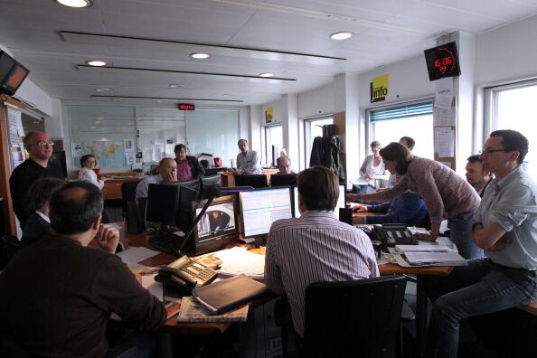 Journalists are pictured during a conference at the head desk office of French radio station France Info on May 23, 2012 in Paris. AFP PHOTO KENZO TRIBOUILLARD        (Photo credit should read KENZO TRIBOUILLARD/AFP/GettyImages)