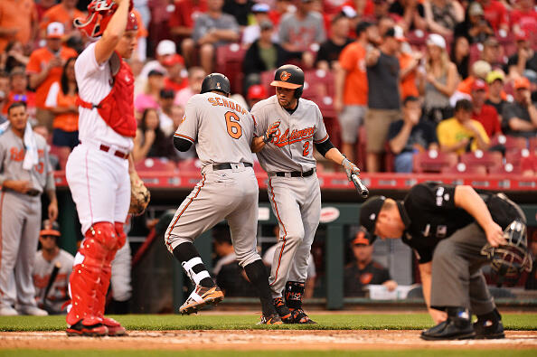 CINCINNATI, OH - APRIL 20: Jonathan Schoop #6 of the Baltimore Orioles celebrates with J.J. Hardy #2 after hitting a solo home run in the second inning against the Cincinnati Reds at Great American Ball Park on April 20, 2017 in Cincinnati, Ohio. (Photo by Jamie Sabau/Getty Images)