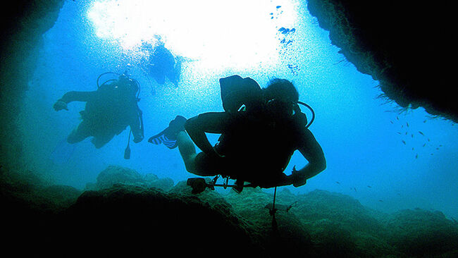 Turkish divers dive at the entrance of a