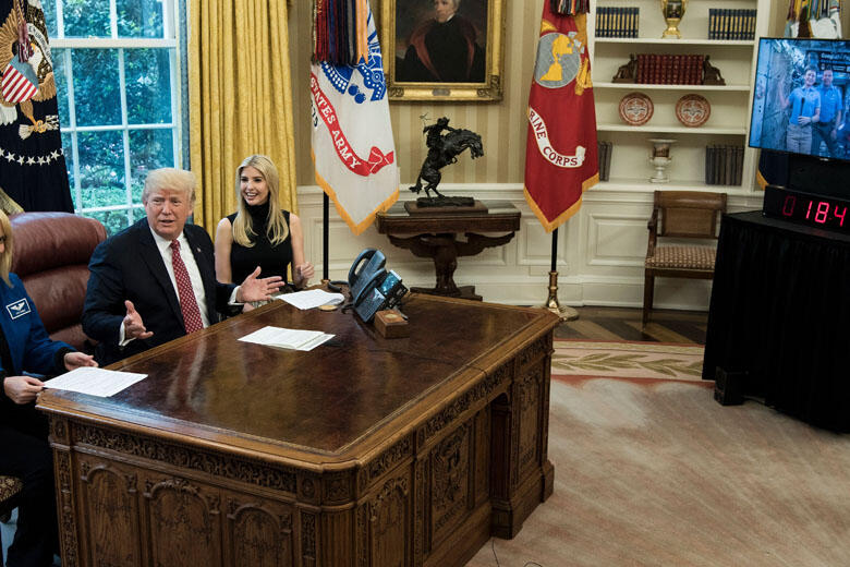 NASA Astronaut Kathleen Rubins (L) and Ivanka Trump (3L) sit with US President Donald Trump (2L) after he spoke via video with NASA astronauts aboard the International Space Station from the Oval Office of the White House April 24, 2017 in Washington, DC.