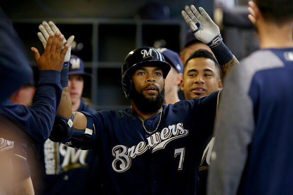 MILWAUKEE, WI - APRIL 24:  Eric Thames #7 of the Milwaukee Brewers is congratulated by teammates after hitting a home run in the first inning against the Cincinnati Reds at Miller Park on April 24, 2017 in Milwaukee, Wisconsin. (Photo by Dylan Buell/Getty Images)