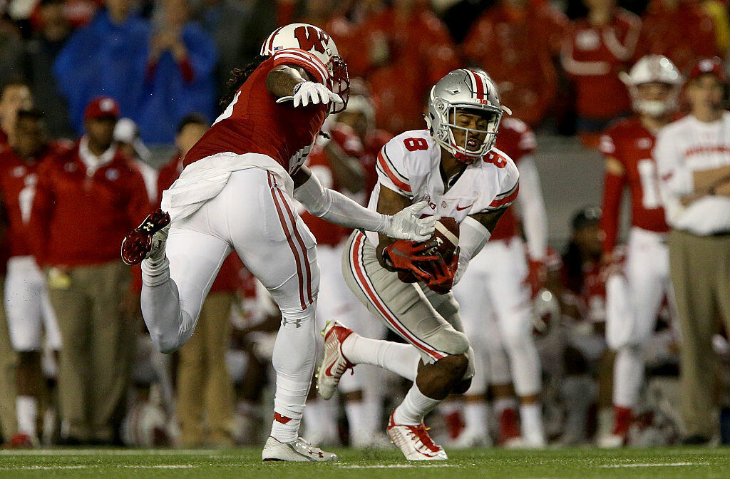MADISON, WI - OCTOBER 15: Gareon Conley #8 of the Ohio State Buckeyes makes an interception in the third quarter against the Wisconsin Badgers at Camp Randall Stadium on October 15, 2016 in Madison, Wisconsin. (Photo by Dylan Buell/Getty Images)