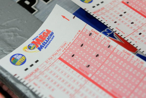 Mega Millions lottery ticket forms at a convenience store on the east side of Manhattan March 30, 2012 in New York. The jackpot is at a record level because no one has matched the magic five numbers and Mega Ball since January 24 -- a full 18 drawings wit
