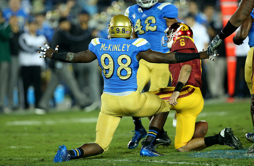 PASADENA, CA - NOVEMBER 22:  Takkarist McKinley #98 of the UCLA Bruins celebrates after sacking quarterback Cody Kessler #6 of the USC Trojans in the third quarter at the Rose Bowl on November 22, 2014 in Pasadena, California.   UCLA on 38-20.  (Photo by