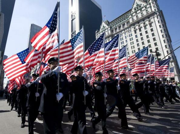 New York City firemen carry US flags dur