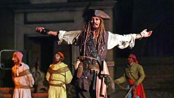 image for Johnny Depp dresses up like Jack Sparrow to surprise guests at Disney land ride