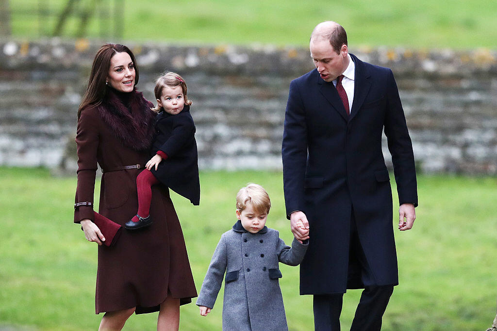 TOPSHOT - Britain's Prince William (R), Duke of Cambridge and Catherine, Duchess of Cambridge arrive with Prince George (C) and Princess Charlotte to attend  a Christmas Day service at St Mark's Church in Englefield on December 25, 2016.  / AFP / POOL / Andrew Matthews        (Photo credit should read ANDREW MATTHEWS/AFP/Getty Images)