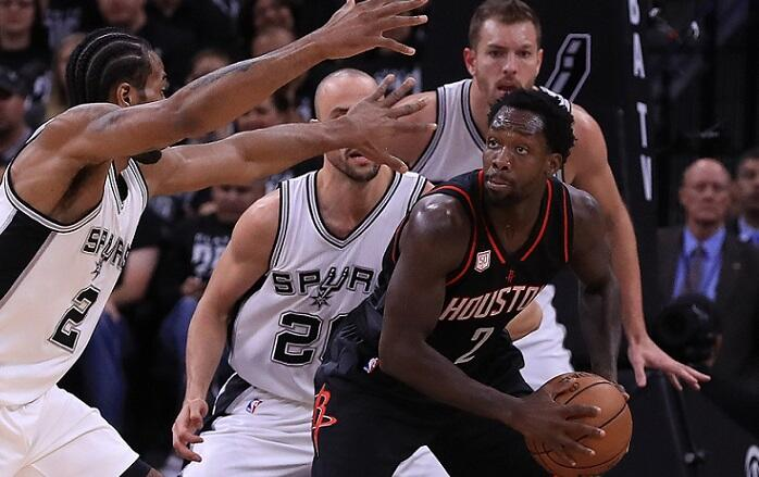 SAN ANTONIO, TX - MAY 01:  Patrick Beverley #2 of the Houston Rockets dribbles the ball against Kawhi Leonard #2 of the San Antonio Spurs in the first quarter during Game One of the NBA Western Conference Semi-Finals at AT&T Center on May 1, 2017 in San A