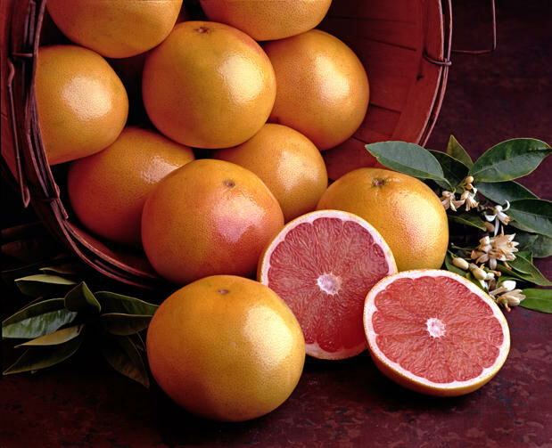 Grapefruits In Basket With Cut Fruit Halves