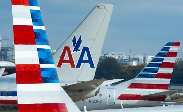 The tails of different versions of American Airlines aircraft are seen on the tarmac November 9, 2016, at Ronald Reagan National Airport in Arlington, Virginia. / AFP / PAUL J. RICHARDS        (Photo credit should read PAUL J. RICHARDS/AFP/Getty Images)