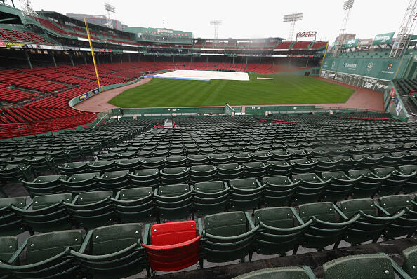 BOSTON, MA - OCTOBER 09:  A red seat marking the spot where Ted Williams hit the longest home run in Fenway Park history is seen as rain falls after game three of the American League Divison Series between the Boston Red Sox and the Cleveland Indians was postponed due to weather at Fenway Park on October 9, 2016 in Boston, Massachusetts.  (Photo by Elsa/Getty Images)