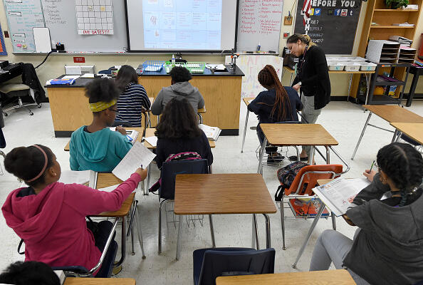 CORRECTION - Science teacher Virginia Escobar-Cheng works with her students in a science class in a high school in Homestead, Florida, on March 10, 2017.  Texas state legislators are now considering a bill introduced in February that would offer teachers like Garlington some legal protection, by giving them latitude to present science