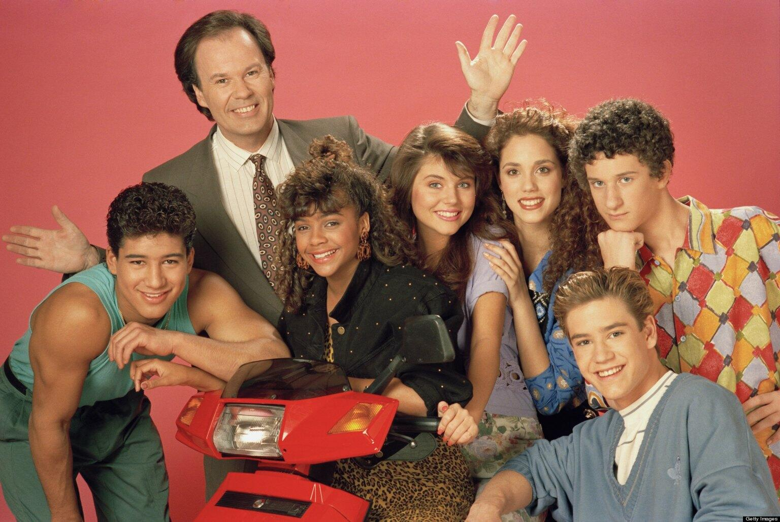 SAVED BY THE BELL -- Season 2 -- Pictured: (l-r) Mario Lopez as Alabert Clifford 'A.C.' Slater, Dennis Haskins as Mr. Richard Belding, Lark Voorhies as Lisa Turtle, Tiffani Thiessen as Kelly Kapowski, Elizabeth Berkley as Jessie Spano, Mark-Paul Gosselaar